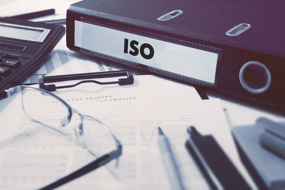 On the Office Desktop with Office Supplies is an office folder with the inscription ISO - International Organization for Standardization